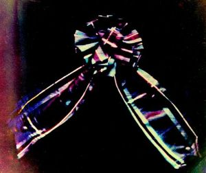 Figure 2: Tartan Ribbon, Photo of projected image by Thomas Sutton, 1861.  Reproduced by permission of the Trustees of the Science Museum, South Kensington, London