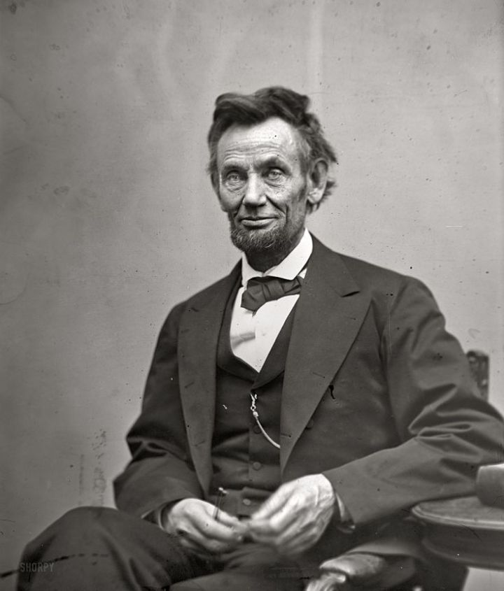 Figure 9:  Abraham Lincoln, seated, holding spectacles and a pencil, Feb 5 1865, Alexander Gardner