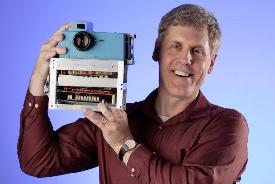 Figure 3:  Steve Sasson, with 1st digital camera, photo by Steve Kelly